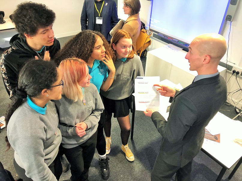 CPS Hate Crime lead, Chris Long, discusses the schools pack with pupils at Thomas Tallis School